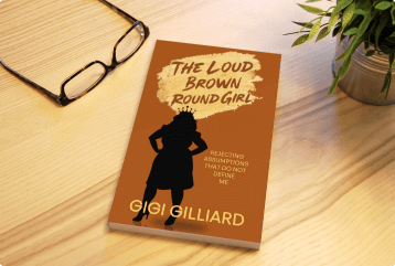 Loud Brown Round Girl book on table